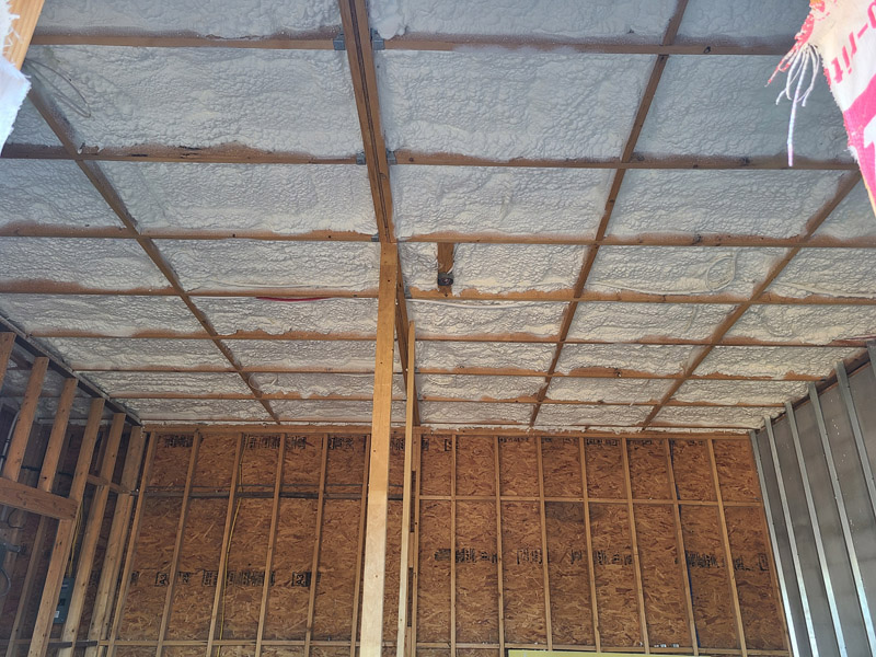 Ceiling with spray foam insulation and wall panels ready for installation in San Antonio TX